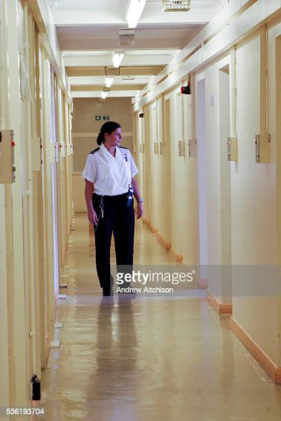 A female prison officer walking down a corridor of C wing at HMP Downview HM Prison Downview is a women's closed category prison Downview is located...