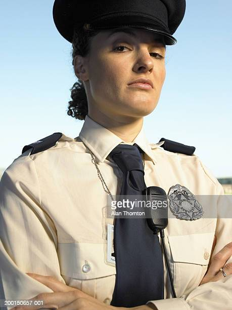 female prison warden, arms folded, portrait - prison guard stock pictures, royalty-free photos & images
