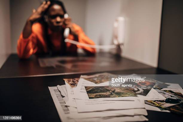 female prisoner in prison visiting room - confession law stock pictures, royalty-free photos & images