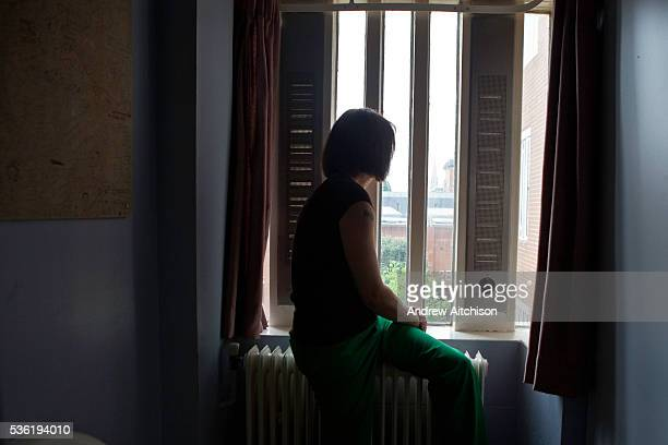 A female prisoner sitting on her bed in the first night dorm at HMP Holloway the main womens prison in London HM Prison Holloway is a closed category...