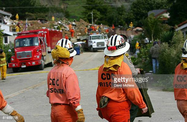 Female prisoners from the California Department of Corrections help in the search for victims of a mudslide that left four people dead and 20 missing...
