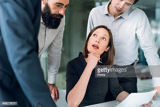 Female professional going over project with team