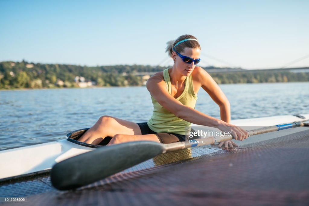 158b7acae2 Female Professional Kayaker With Paddle And Kayak Stock Photo ...
