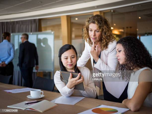 Female professional looking at digital tablet