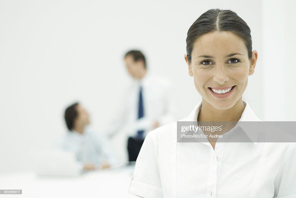Female professional smiling at camera, portrait : Stock Photo