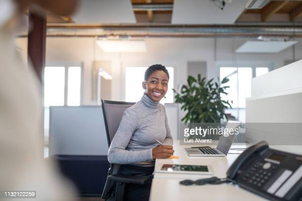 female professional working at her desk - businesswear stock pictures, royalty-free photos & images