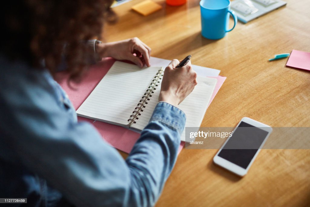 Female professionals making notes : Stock Photo