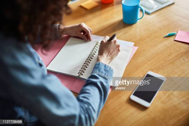 female professionals making notes - writer stock pictures, royalty-free photos & images
