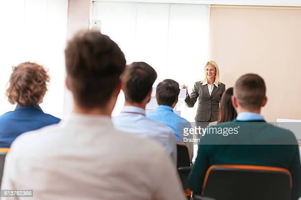 Female professor having lecture with her students