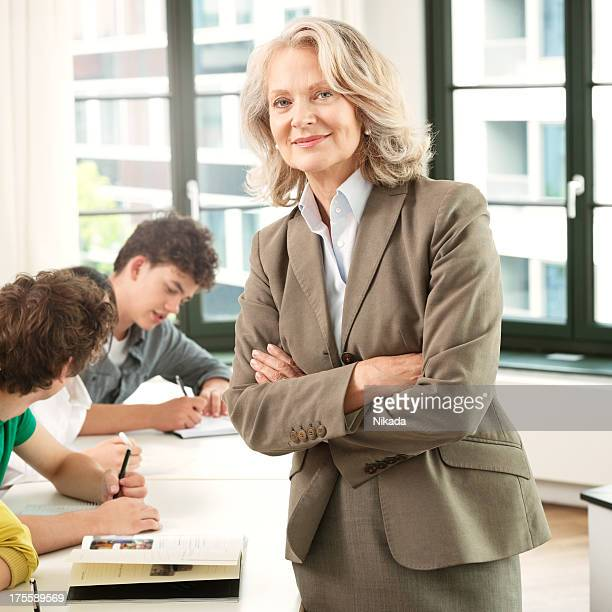 Female Professor With Students In Classroom