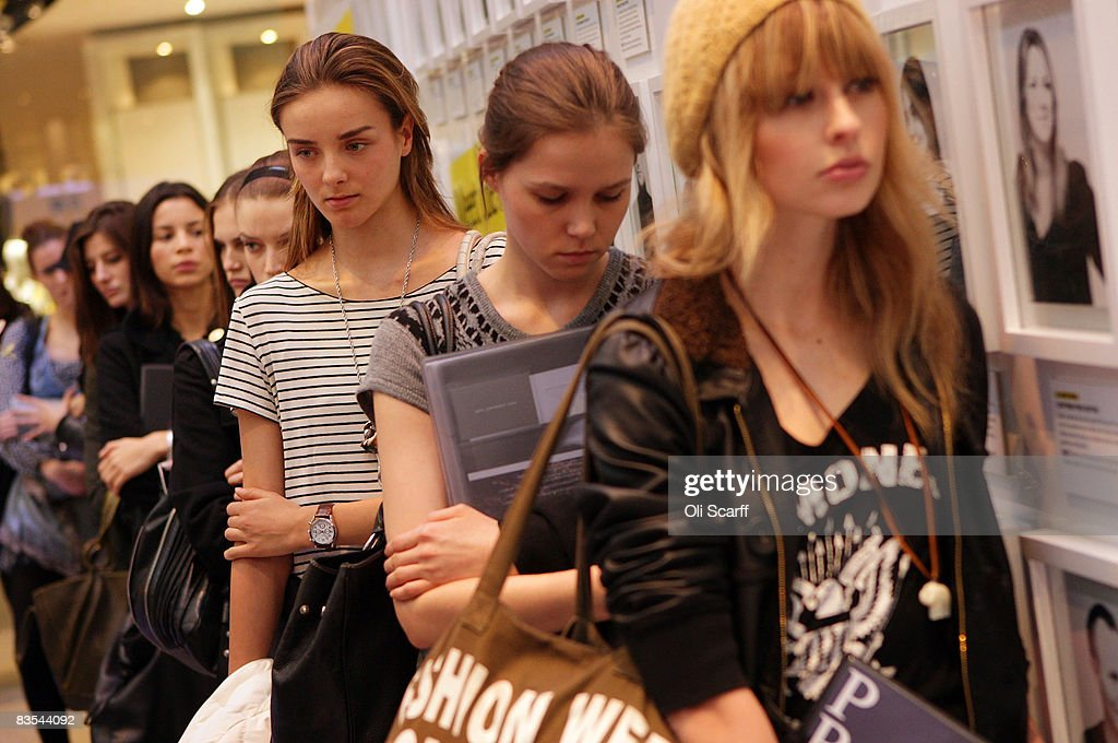 Female prospective models queue outside the temporary Grazia office in the Westfield shopping centre, London on November 3, 2008. For one week the fashion magazine Grazia is being produced in a temporary office inside the Westfield shopping centre, they are offering shoppers: free make-overs, style tips and advice for those pursuing a modeling career.