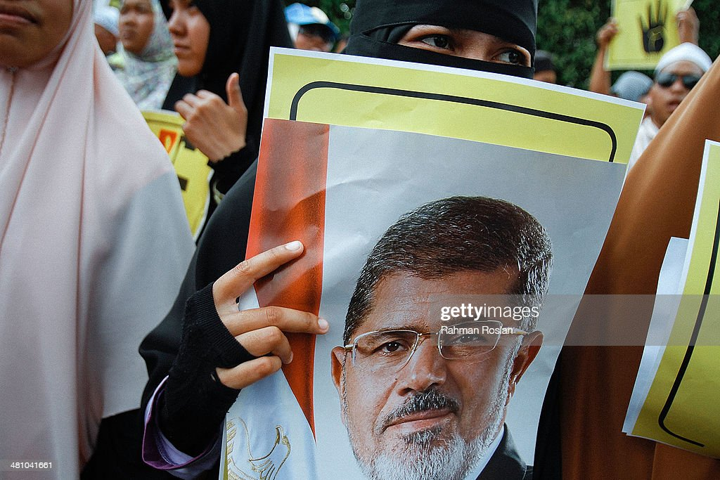 Demonstration Held Outside Kuala Lumpur's Egyptian Embassy : News Photo