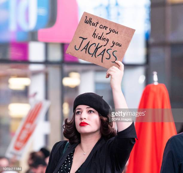 A female protester holds a placard during the rally Thousands took to Times Square of New York City during a rally to support Robert Mueller's...