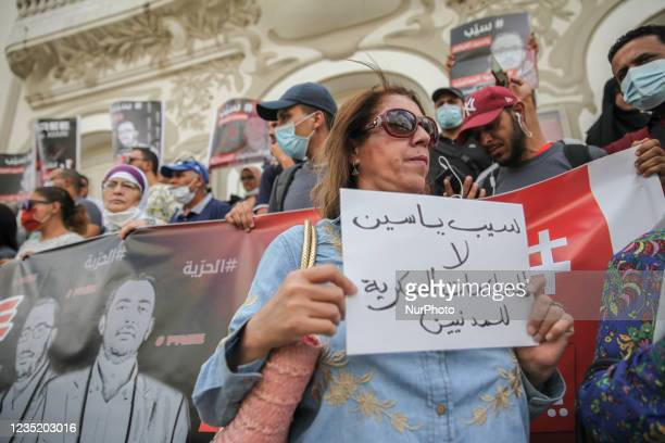 Female protester holds a placard that reads in Arabic release Yassine Ayari, no to the military trials of civilians, during a demonstration held in...