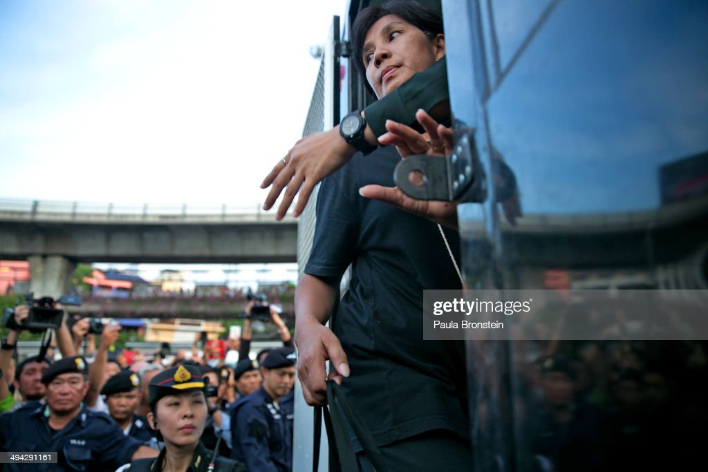 A female protester is arrested by Thai authorities after expressing her views for peace after streets were blocked by the military in order to stop the anti-coup protesters from arriving to the Victory Monument on May 29, 2014 in Bangkok, Thailand. The Thai military has warned Thai citizens about expressing dissent using social media. Thailand is known as a country with a very unstable political record and is now experiencing it's 12th coup with 7 attempted pervious coups.