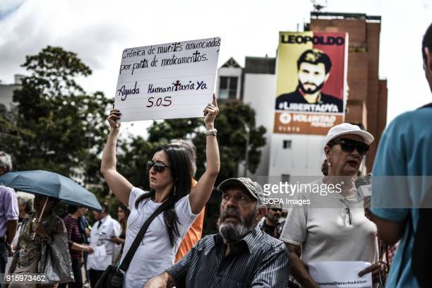 A female protester seen displaying a placard during the demonstration People gathered in Caracas to protest against the lack of medicines in...