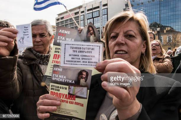 A female protester seen displaying her placards during the demonstration Greek East Orthodox Church supporters demonstrate in Athens under the slogan...