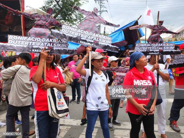 MENDIOLA MANILA PHILIPPINES Female protesters are seen holding cardboards replica of Andres Bonifacio during the protest Leftist groups stage...