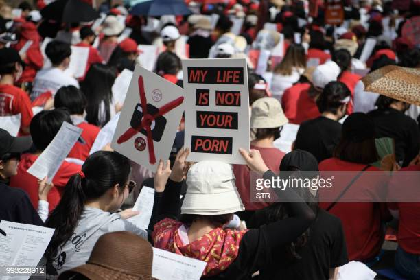 Female protesters call for South Korea's government to crack down on widespread spycam porn crimes during a rally in Seoul on July 7 2018 Socalled...