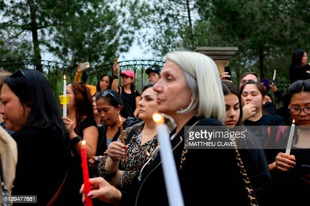 Female protesters hold candles as they demonstrate in support of the victims of a suspected serial killer in front of the presidential palace in...