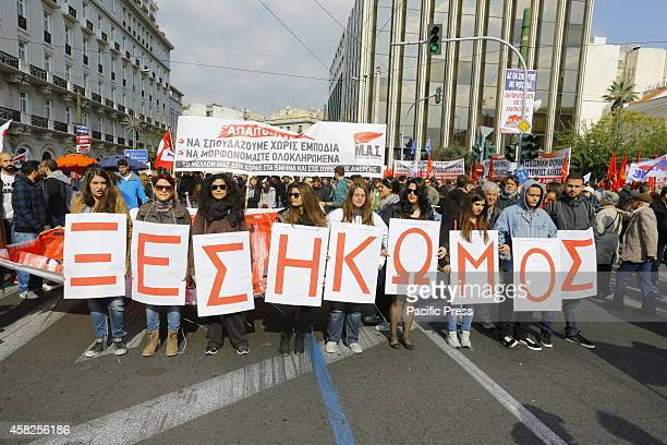 Female protesters hold signs that read 'Uprising'. Thousands of protesters assembled in Athen's Syntagma Square under the banner of the Greek...