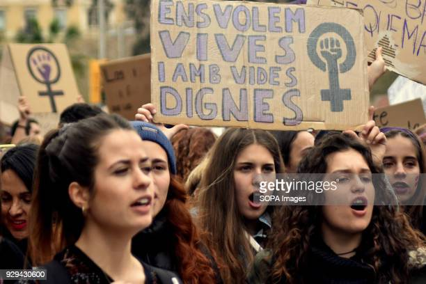 Female protesters seen holding placard during the March 8 international women's day to demand equal better salary and more dignity in the work...