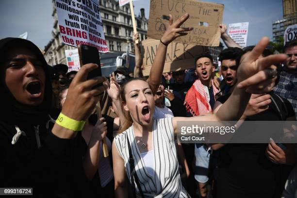 Female protesters shout at cameras as they call for justice for the victims of the Grenfell Disaster in Parliament Square during an antigovernment...
