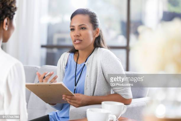 female psychiatrist discusses something with female patient - counseling stock pictures, royalty-free photos & images