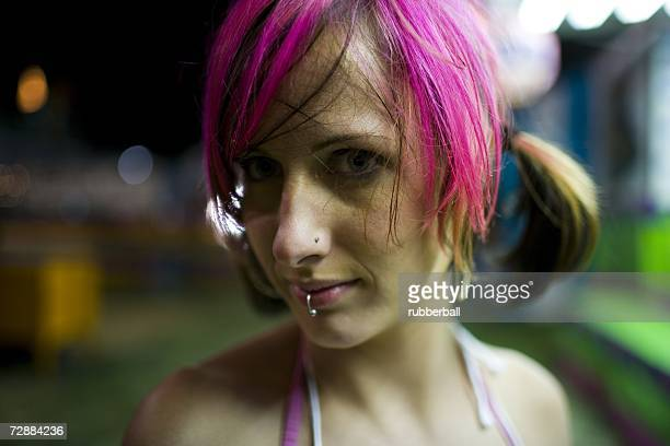 Female punk with dyed pink hair