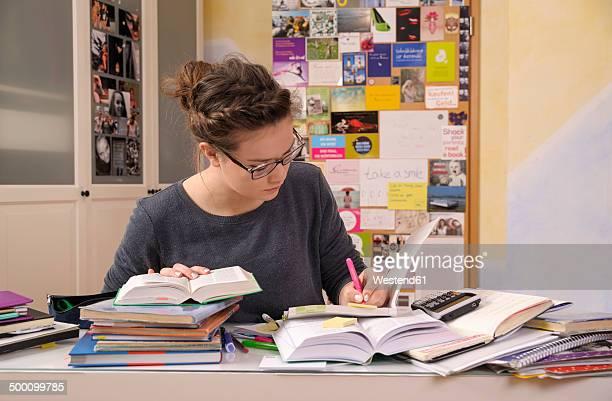 Female pupil doing homework