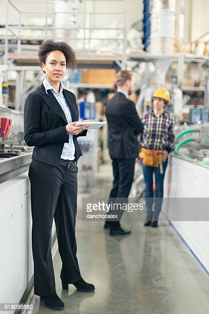 Female quality control inspector at the factory