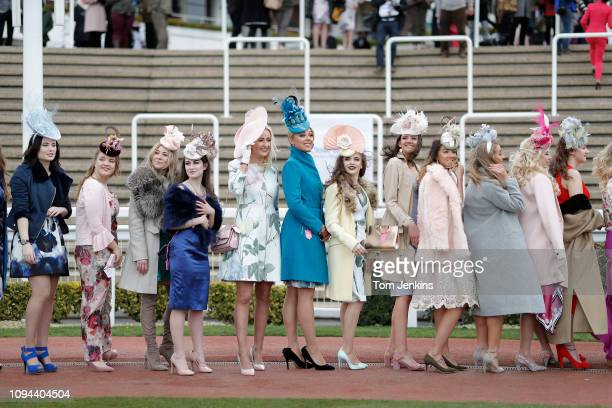 Female racegoers lining up during day two Ladies Day of the 2018 Cheltenham National Hunt Festival at Cheltenham Racecourse on March 14th 2018 in...