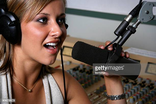 Female radio DJ at the mic