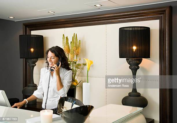 Female receptionist talking on the phone