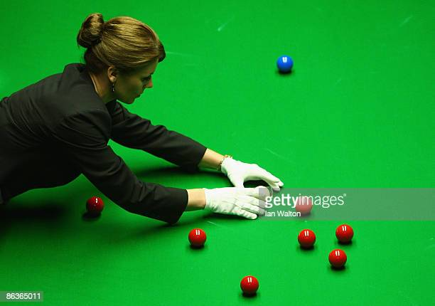 Female referee Michaela Tabb lines during the John Higgins of Scotland and Shaun Murphy of England final match at the Betfred Snooker World...