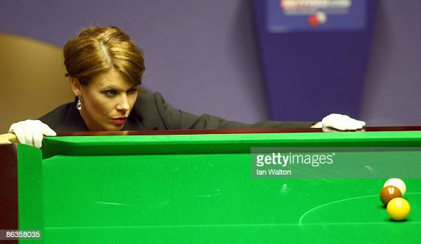 Female referee Michaela Tabb lines up the balls during the John Higgins of Scotland and Shaun Murphy of England final match at the Betfred Snooker...