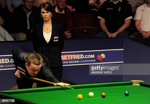 Female referee Michaela Tabb watches as Britain's Shaun Murphy plays a shot during the World Snooker Championship final at the Crucible Theatre in...