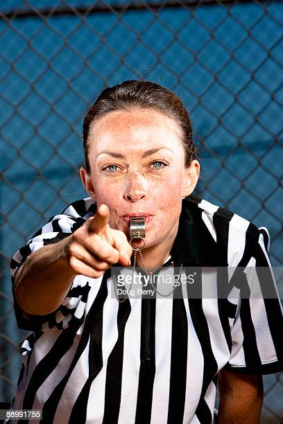 Female referee with whistle and stripped shirt