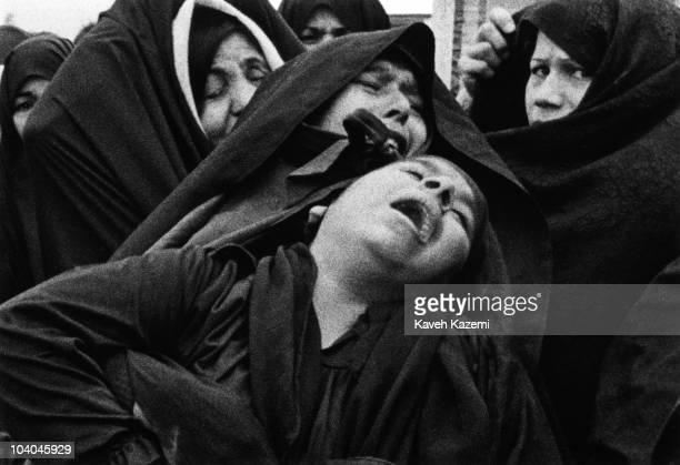 Female relatives of an air raid victim mourn his death on Norouz at Behesht Zahra cemetery, Tehran, Iran, during the Iran-Iraq War, 21st March 1981.
