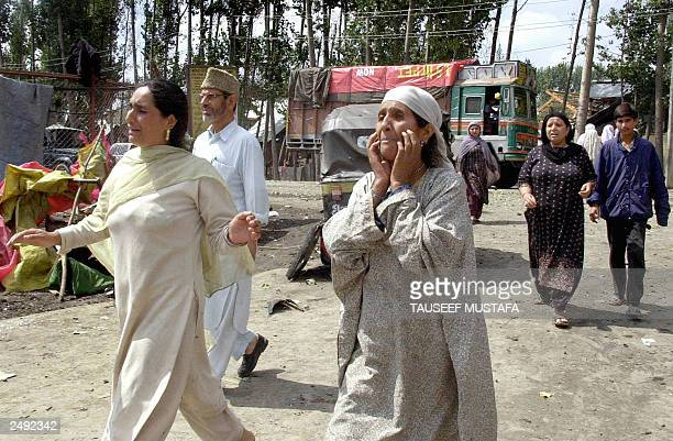 Female relatives of Indian Kashmiri man Abdul Samad express their grief in Srinagar 06 September 2003 after he was killed by a blast in which...