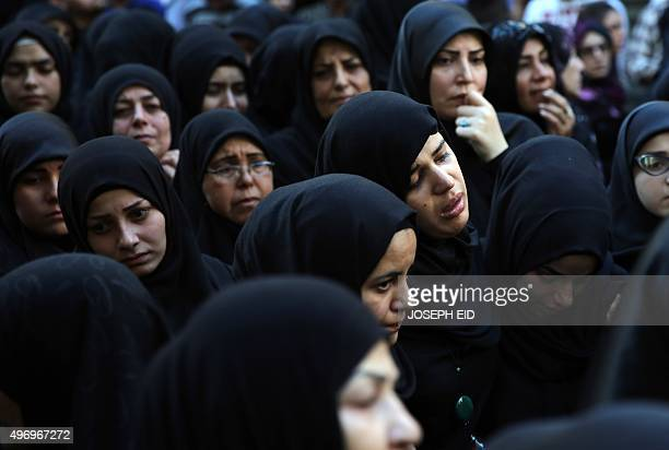 Female relatives of Samer Huhu, who was killed in a twin bombing attack that rocked a busy shopping street in the area of Burj al-Barajneh, mourn...