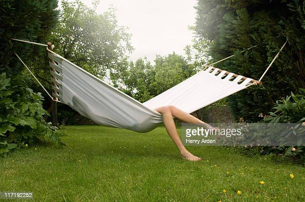 Female relaxing in hammock