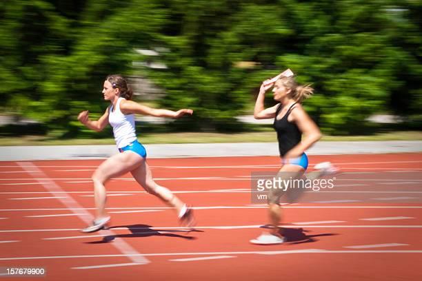 female relay baton - relay baton stock photos and pictures
