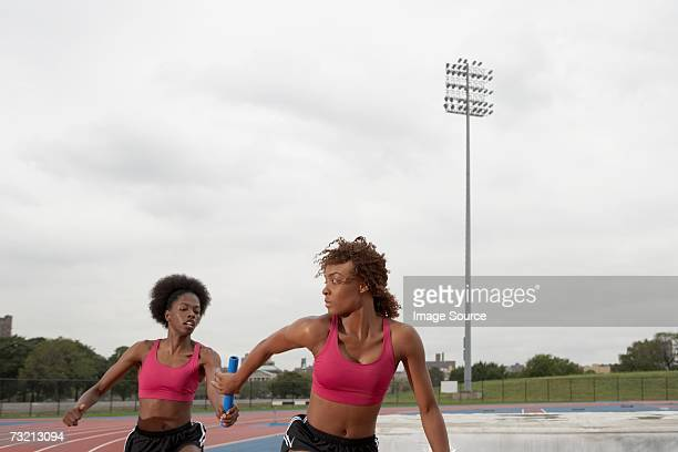 female relay race - passing sport stock pictures, royalty-free photos & images