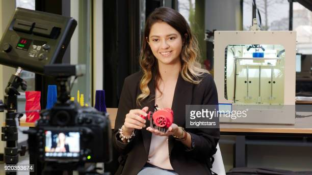 Female reporter in a 3D printing office