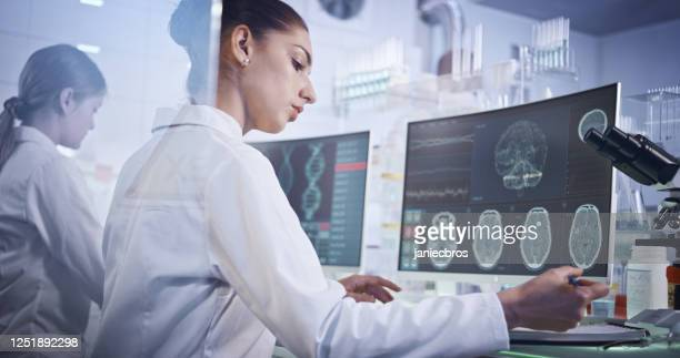 female research team studying brainwave scanning - eeg stock pictures, royalty-free photos & images