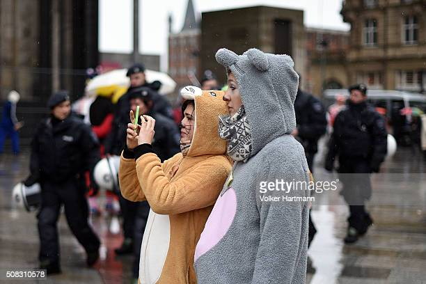 Female revellers take pictures during 'Weiberfastnacht' celebrations as part of the carnival season on February 4 2016 in Cologne Germany Carnival...