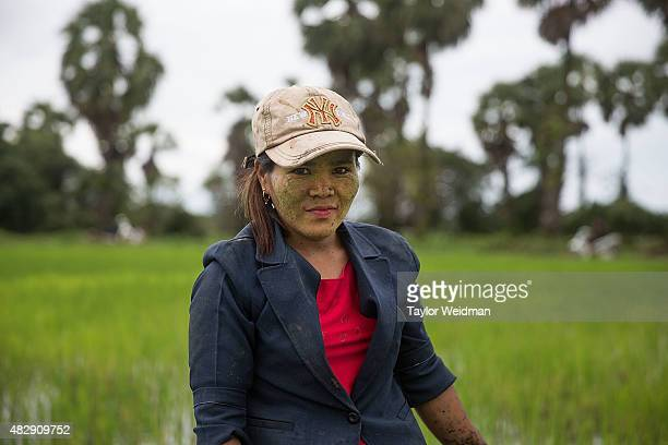 A female rice farmer poses for a portrait in a field inside the planned Dawei SEZ on August 3 2015 in Nabule Myanmar The controversial multibillion...