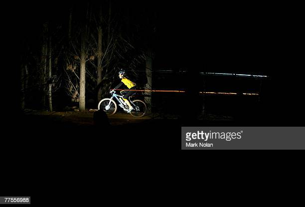A female rider leaves a light trail as she makes her way through single track at night during the Mont 24 Hour MTB Race held at Majura Pines forest...