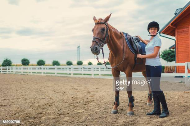 female rider with her horse - riding hat stock pictures, royalty-free photos & images